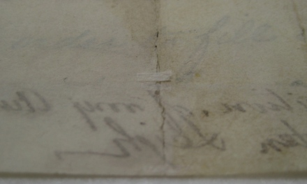 Figure 6: Small suture before it was pasted down on the verso of the manuscript.